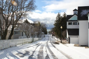 Snowy streets lead to lake at Mackinac Island